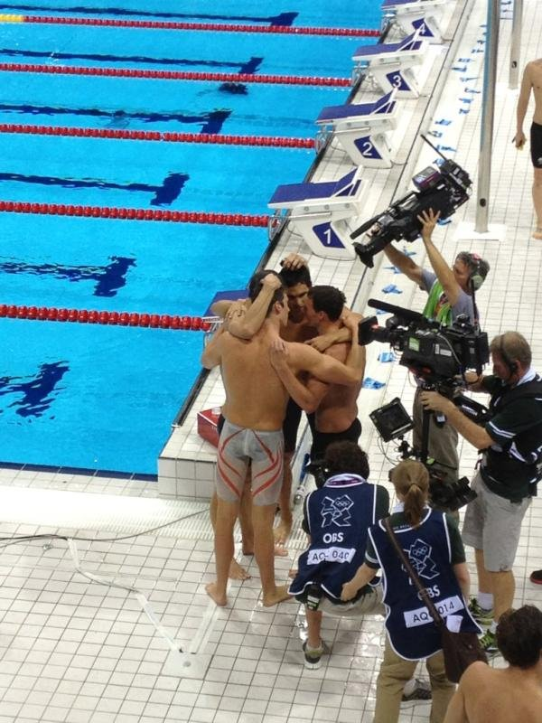 Bar Refaeli captured a sweet moment between the US men's swimming team.  Source: Twitter user barrefaeli