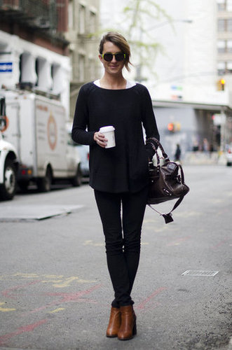 Rework a classic crewneck with standout sunglasses and buttery ankle boots. Source: Adam Katz Sinding