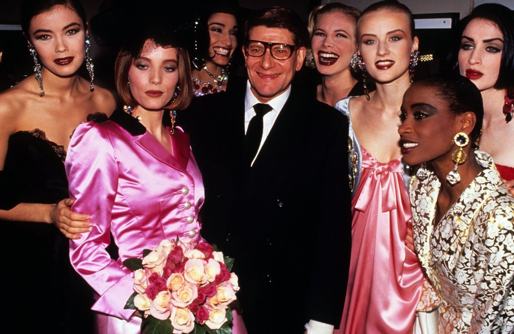 Yves Saint Laurent and his models posed backstage after his Spring/Summer '96 haute couture show.