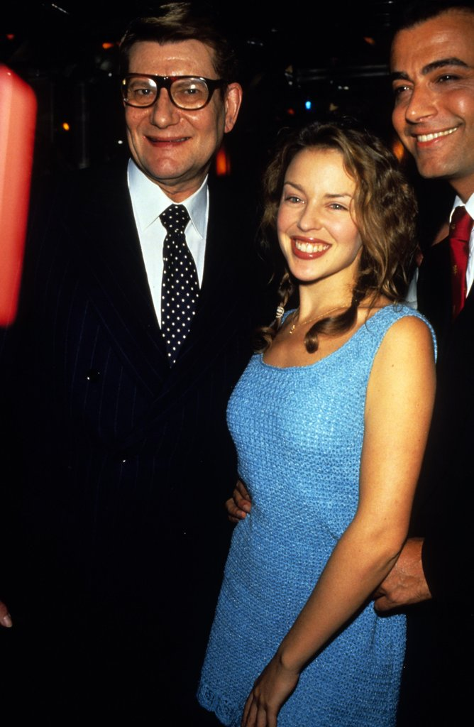 YSL posed with a young Kylie Minogue in 1998.