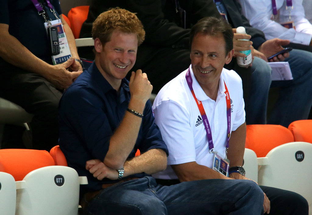 Prince Harry had a laugh while watching the swimming at the Olympics.