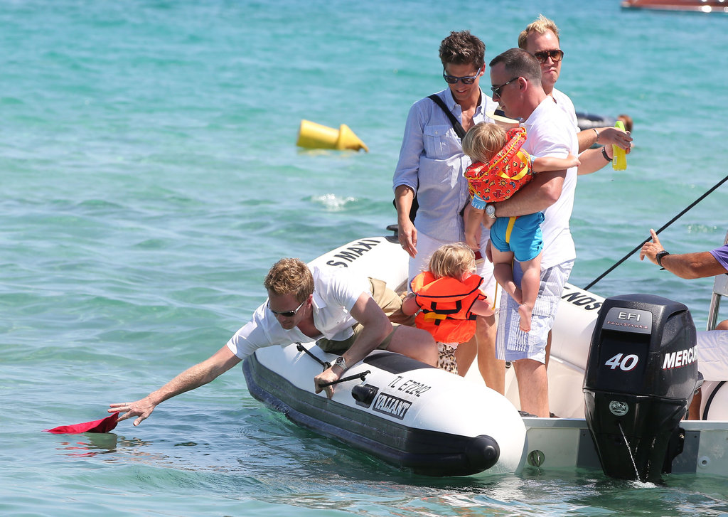 Neil Patrick Harris reached for something off the side of the boat.