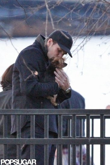 Tom Brady kissed Gisele Bundchen's pup, Vida, during a November 2011 stroll around Boston.