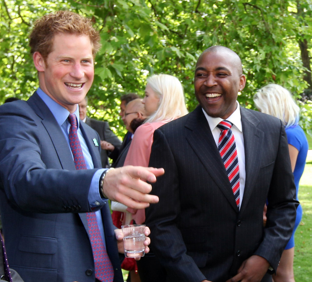 Prince Harry shared a laugh with Olympic Gold medalist Darren Campbell at an event in London.