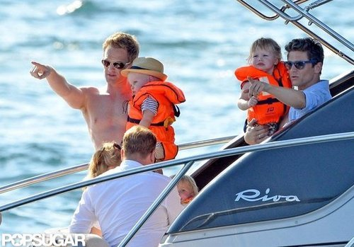 Neil Patrick Harris and David Burtka held Gideon and Harper while they took a boat ride near St.-Tropez with Elton John's family in June 2012.