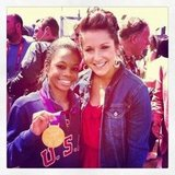 Carly Patterson posed with Gabby Douglas and her gold medal.  Source: Twitter user CarlyPatterson