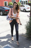 Jessica Alba continued to impress with her off-duty wardrobe, this time in skinny denim and a floral-print handbag while on the go in LA.
