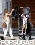 Gisele Bundchen put luggage on a rack also holding Jack Moynahan.