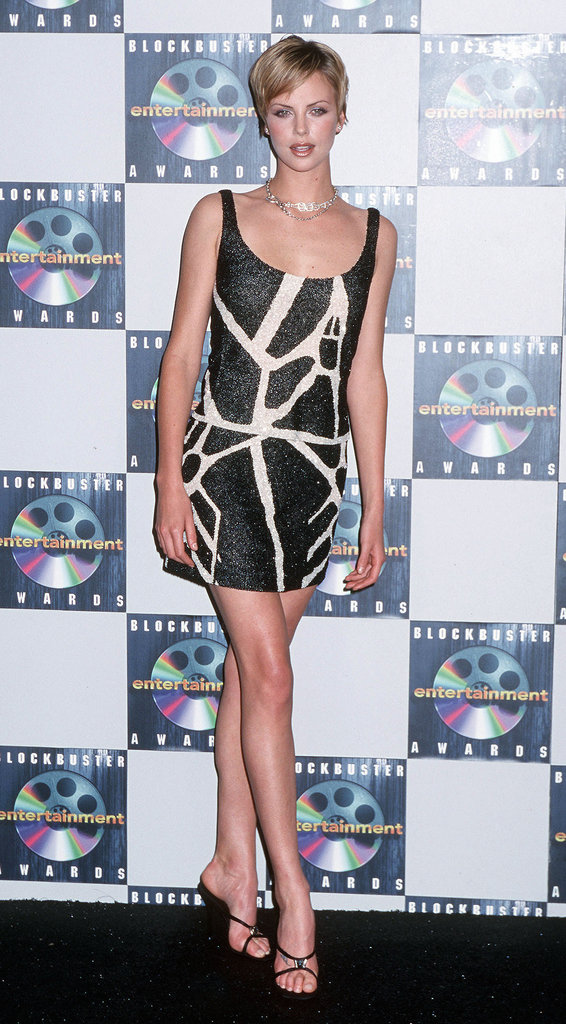 Charlize Theron showed off her mile-long legs in a fitted minidress at the Blockbuster Awards in May 2000.