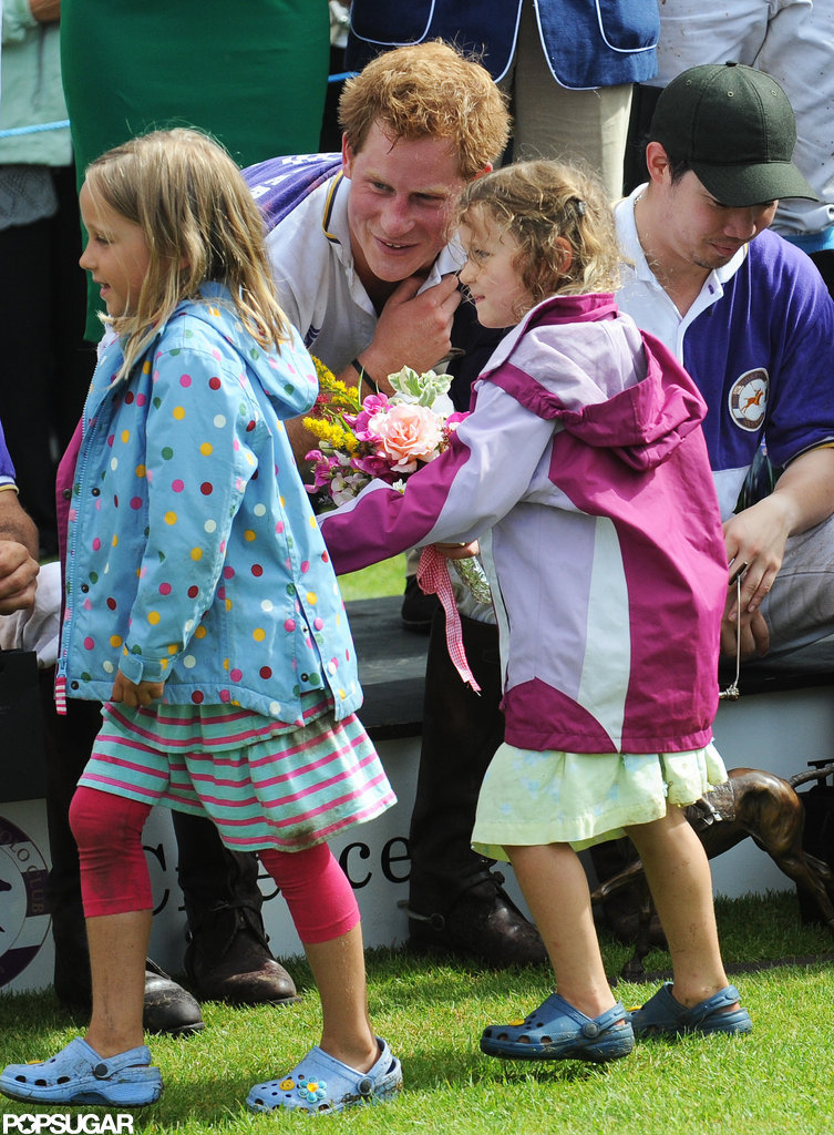 Prince Harry greeted some young fans at a polo match.