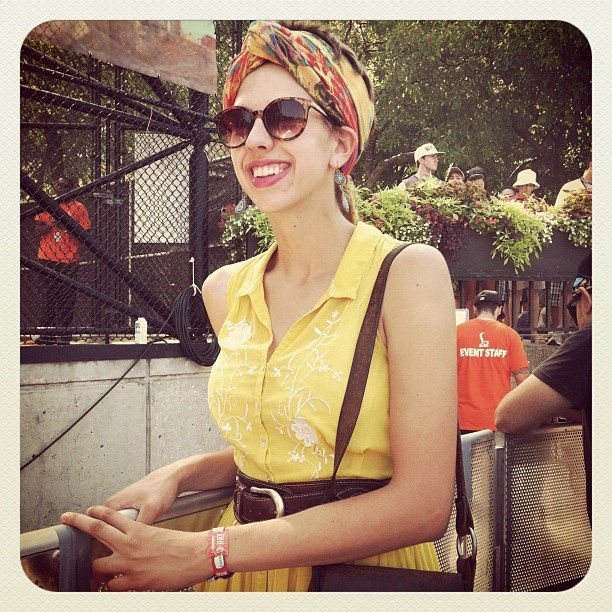 Her colorful head scarf added an extra dose of vibrancy to her already bright yellow dress ensemble.