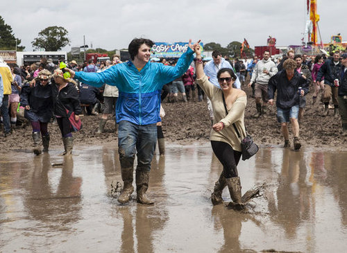A pair walked through the mud at the Isle of Wight Festival 2012 at Seaclose Park.