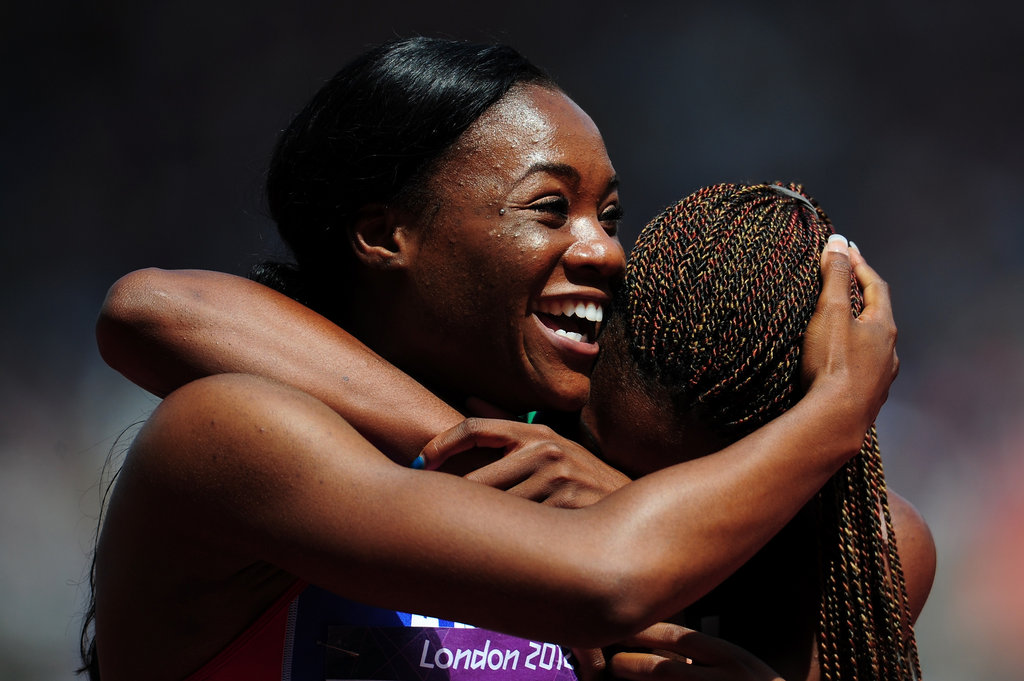 Marlena Wesh of Haiti gave a big smile after competing in the women's 400m heats.