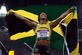 Shelly-Ann Fraser-Pryce of Jamaica ran with her flag after winning the gold in the women's 100m final.