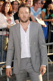 Joel Edgerton kept it casual with an opened collar button down shirt.