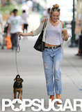 Miley Cyrus was joined by Happy, her and Liam Hemsworth's rescue puppy, on a August 2012 coffee run in LA.