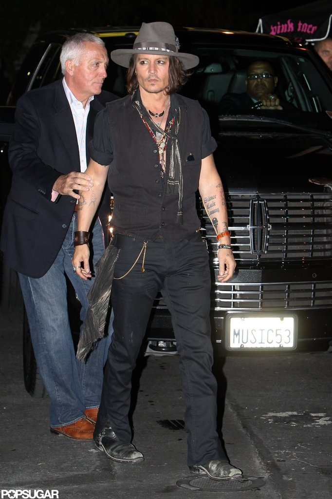 Johnny Depp walked into Aerosmith's afterparty in LA.