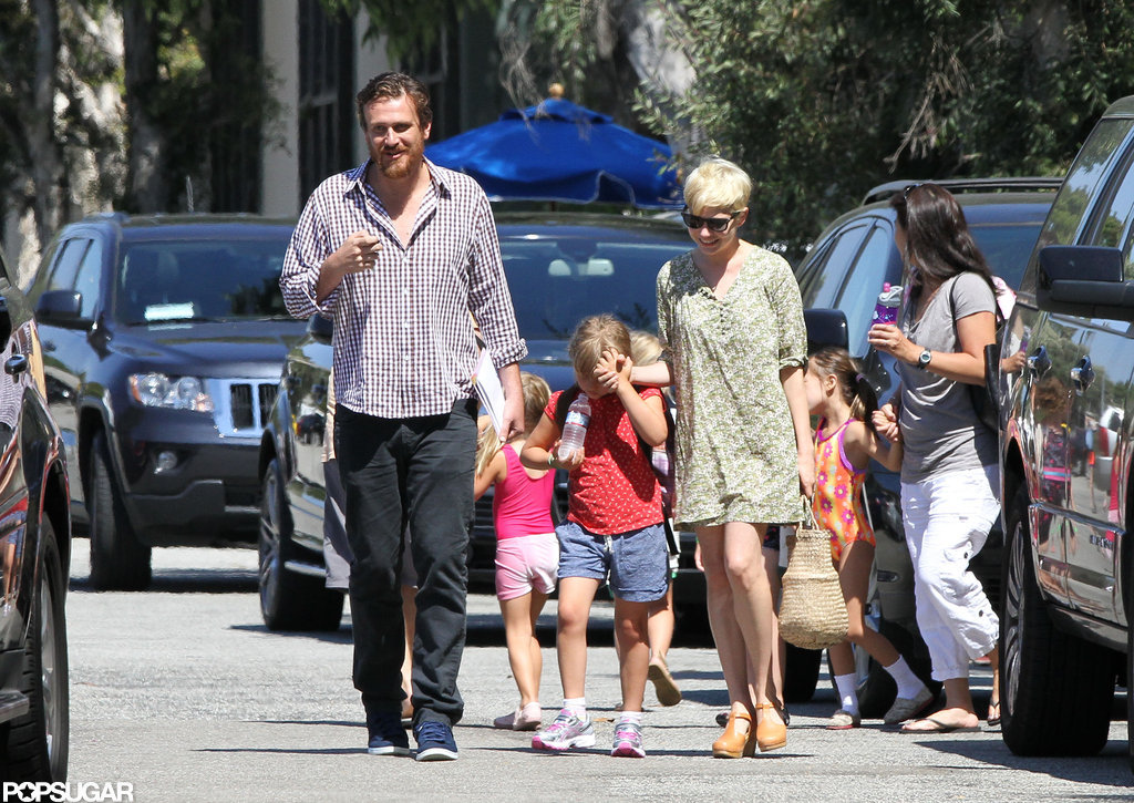 Michelle Williams and Jason Segel walked with Matilda in LA.