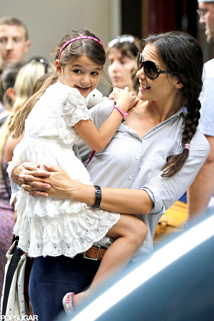 Katie Holmes smiled while holding daughter Suri Cruise.