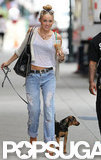Miley Cyrus wore boyfriend jeans and a white cropped tee while walking with her dog, Happy, in Philadelphia.