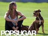 Gisele Bundchen relaxed next to a dog.