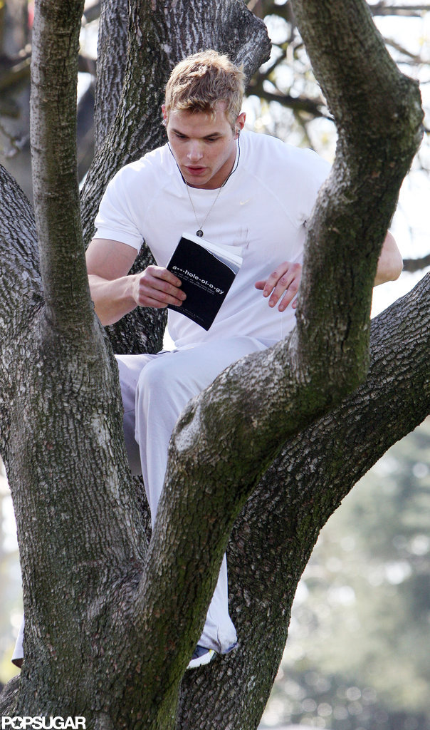 Kellan Lutz took a copy of A**holeology: The Science Behind Getting Your Way — and Getting Away With It into a tree in February 2010 in LA.