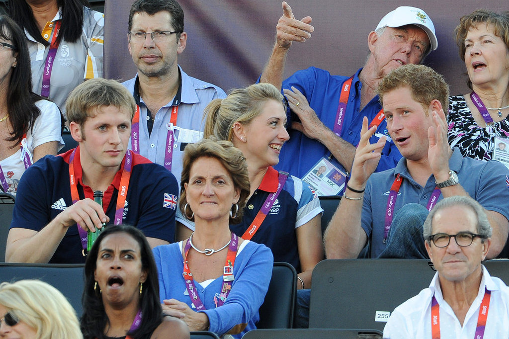 Prince Harry, Jason Kenny, and Laura Trott chatted while watching beach volleyball.