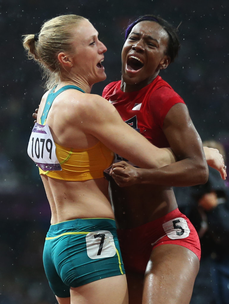 Gold medalist Sally Pearson of Australia hugged silver medalist Kellie Wells of the United States after they completed the women's 100m hurdles final.