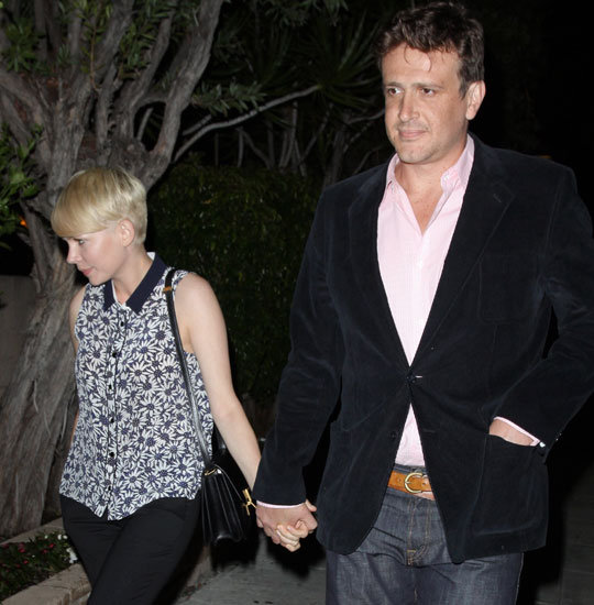 Michelle Williams held Jason Segel's hand during a date night.