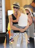 Gwen Stefani carried Zuma through LAX.