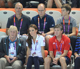 Kate Middleton, Prince Albert, and Ambassador Robin Cousins concentrated on the women's synchronized swimming event.