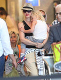 Gwen Stefani arrived at LAX carrying Zuma while Kingston followed behind.