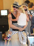 Gwen Stefani cuddled with Zuma at LAX.
