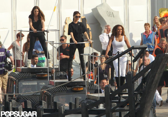Victoria Beckham, Melanie Brown, and Melanie Chisholm practiced for the closing ceremony as the Spice Girls.