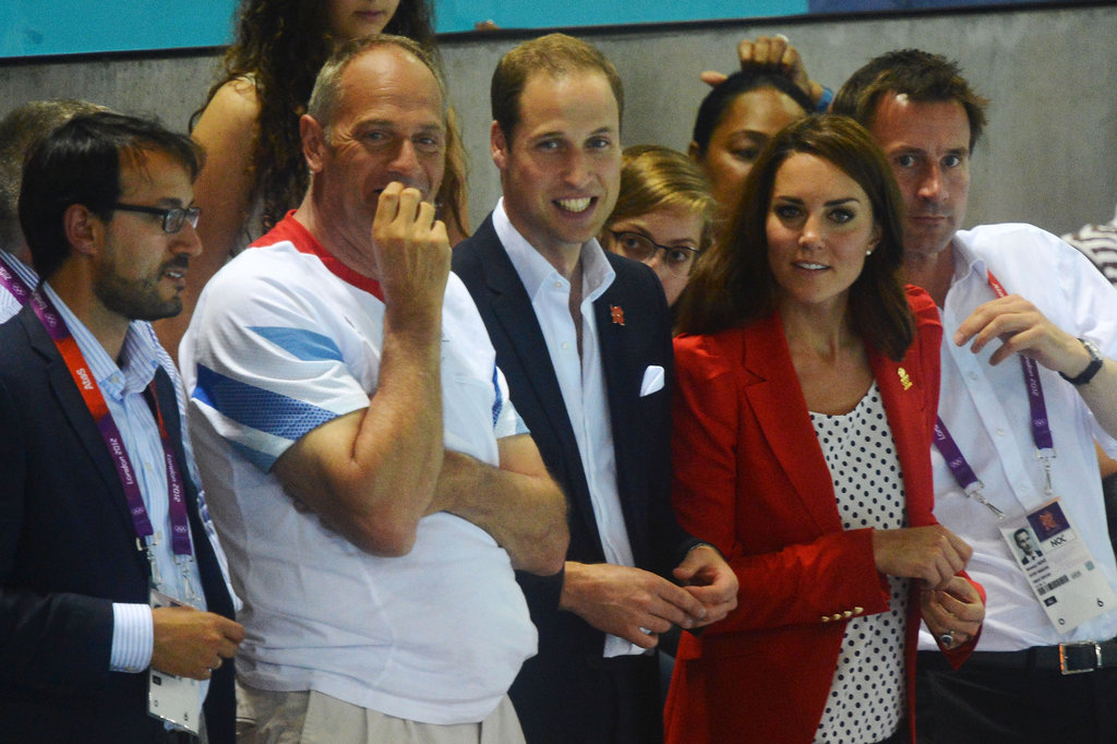 Kate switched up her usual navy blazer-and-white-polo outfit with a decidedly more playful and printed touch. We spotted her (literally) in a polka-dotted top and slick red blazer at the Olympic swimming pool.