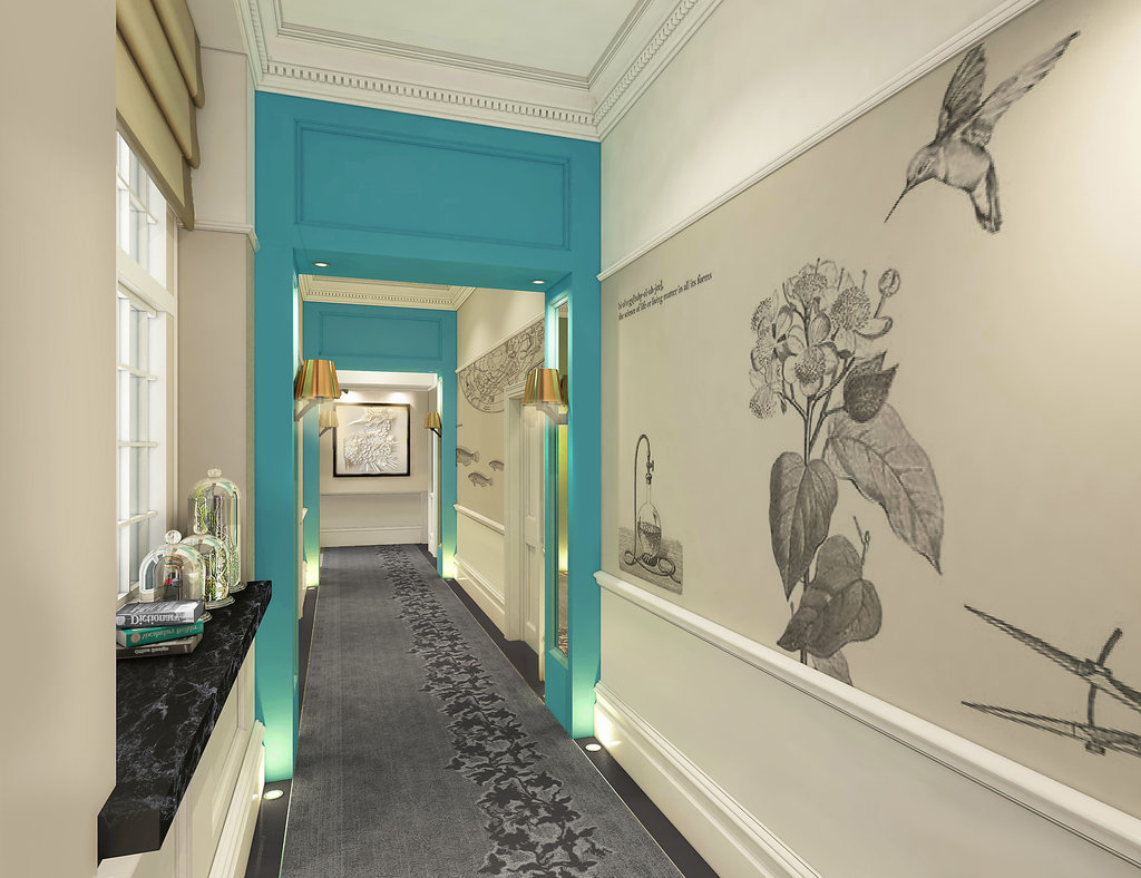 A collection of curiosities are housed under bell jars on a shelf in the hallway, while a turquoise doorway creates a lovely color pop. We also can't forget the amazing wall treatment!
