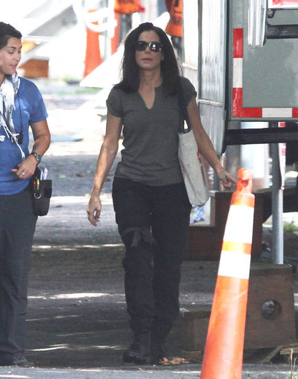 Sandra Bullock chatted with a production assistant on the set of The Heat in Cambridge, MA.