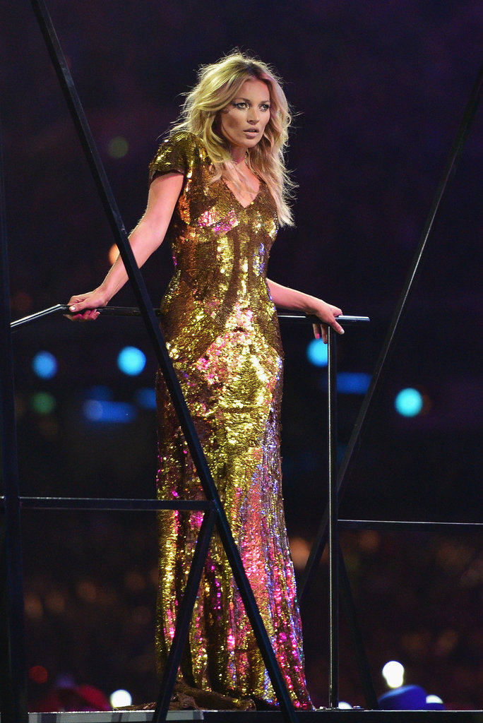 Kate Moss glowed in a floor-length creation by longtime friend Alexander McQueen.