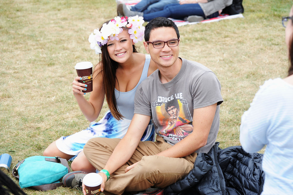 Cute concert-going couple alert — we love his vintage music t-shirt and her tie-dye skirt. Looks like we've got two festival fashion finds here.