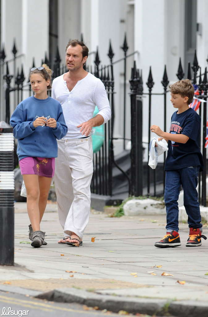Jude Law shopped with his kids Iris and Rudy in London.