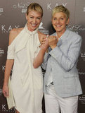 Ellen DeGeneres and Portia de Rossi showed off their wedding bands at a July 2010 event in LA.
