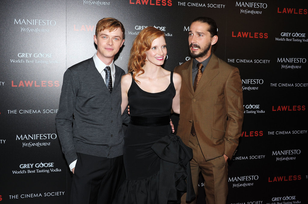 Jessica Chastain posed between costars Shia LaBeouf and Dane DeHaan at the screening of Lawless in NYC.