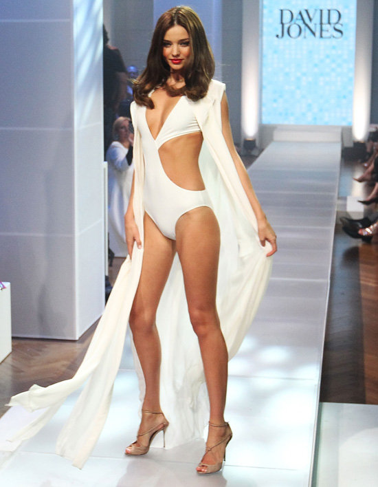 Miranda Kerr Shows Skin in a White Cutout Swimsuit