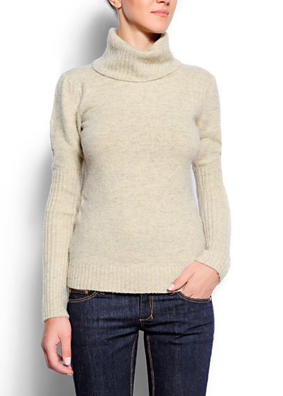 This relaxed turtleneck looks cool while keeping you warm. Mango Relaxed-Fit Knit Sweater ($35, originally $70)