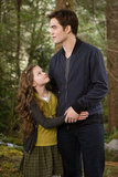 Edward plays dad to Renesmee in Breaking Dawn Part 2.
