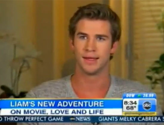 "Liam Hemsworth Talks Catching Fire and Miley's ""Fantastic"" New Haircut"