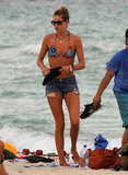 Doutzen Kroes donned a pair of denim shorts on the beach.