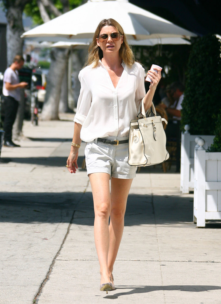 Ellen Pompeo looked sophisticated while heading to American Rag in LA — her white Michael Michael Kors bag may have had something to do with it, but we're pretty sure her silky white blouse and snakeskin pumps were appropriately chic add-ons, too.
