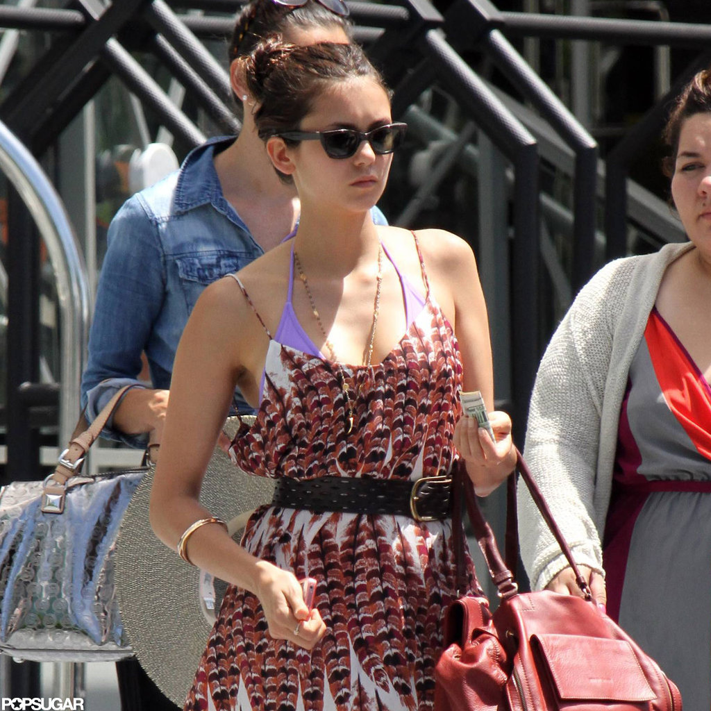 Nina Dobrev Covers Up a Bright Bikini For a Stroll in South Beach