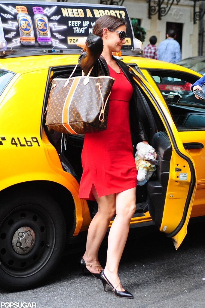 Katie Holmes got out of a taxi in NYC.